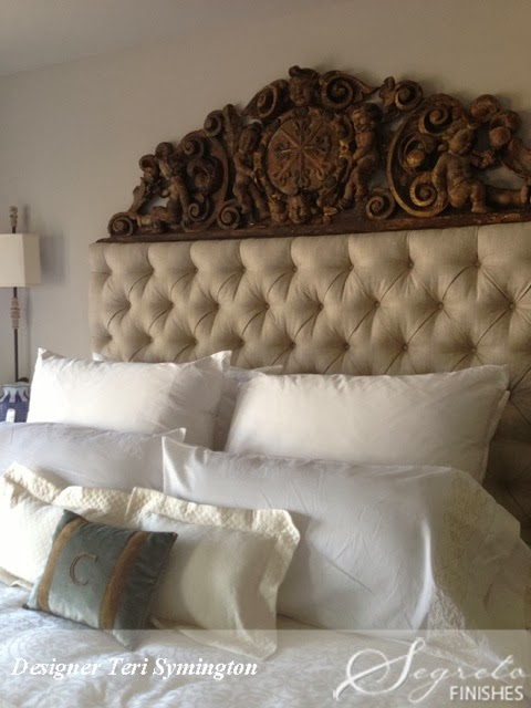 A beautiful wood carving has been added to this tufted headboard for an exquisite romantic look. & Eye For Design: Decorating With Tufted Headboards pillowsntoast.com