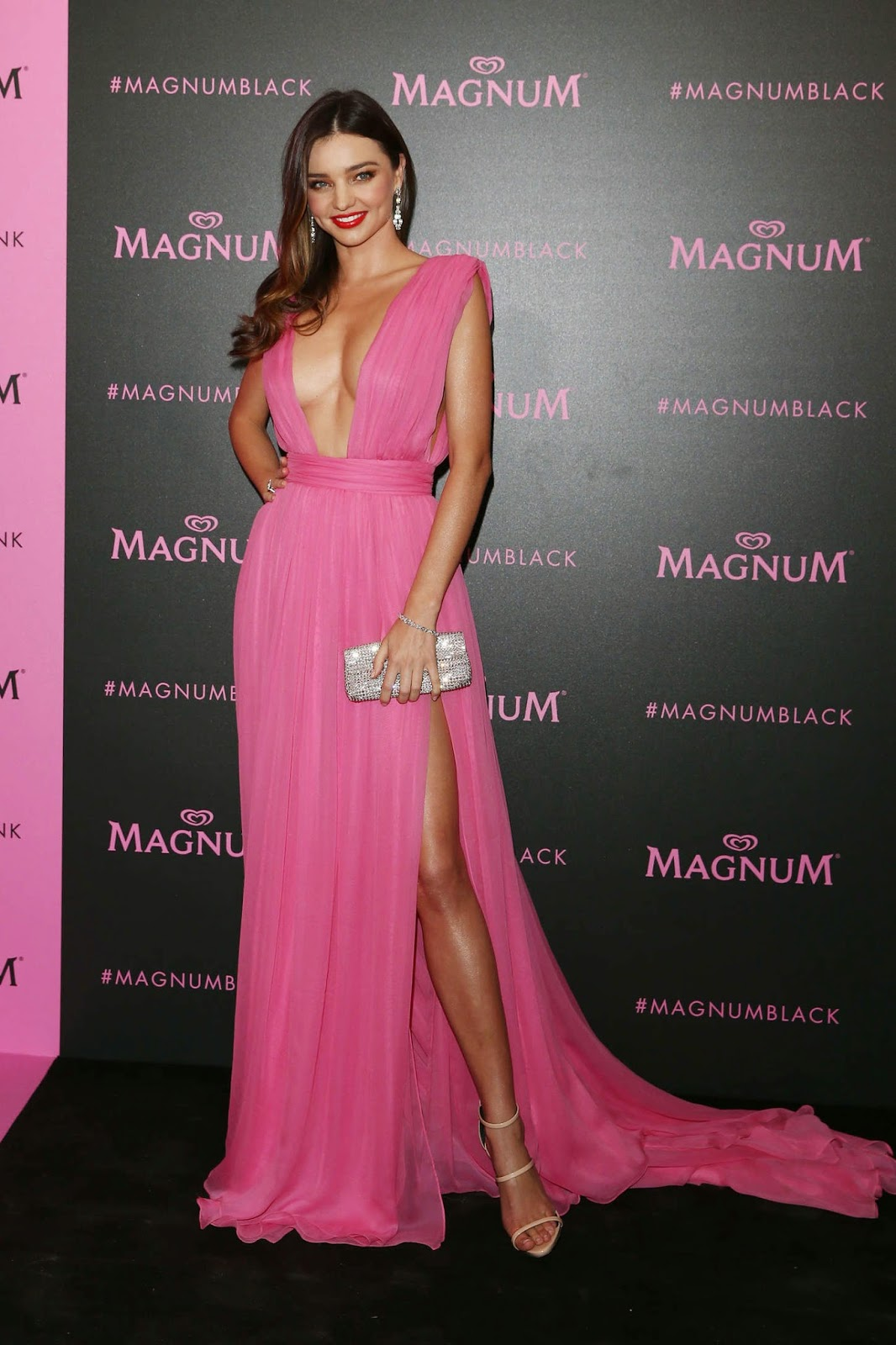 Miranda Kerr stuns in a plunging pink dress at the Magnum Pink and Black Cannes Party