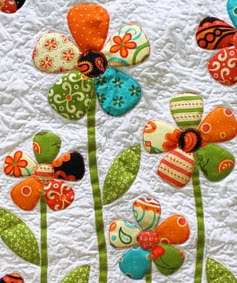 http://www.craftpassion.com/2013/03/flower-applique-pattern.html