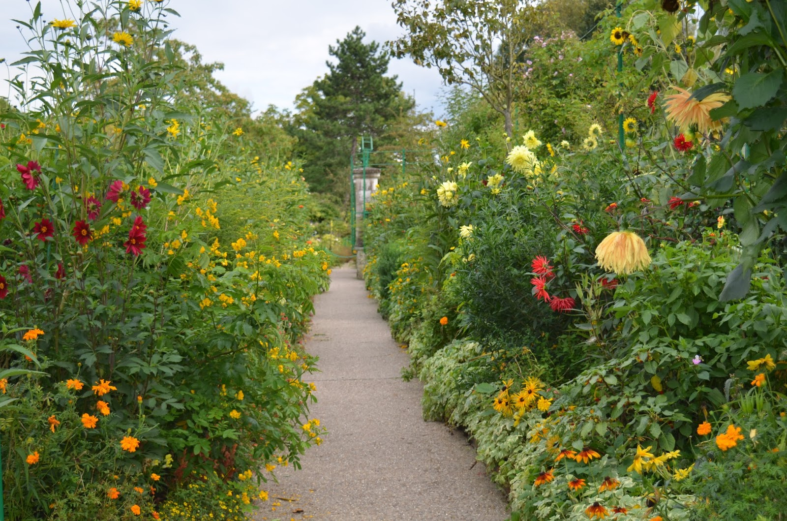 Beautiful flower garden path - Every Path Contains A New Treasure Of Plants And Color Combinations Monet Has Over 200 000 Annuals Biennials And Perennials On Display In His Garden