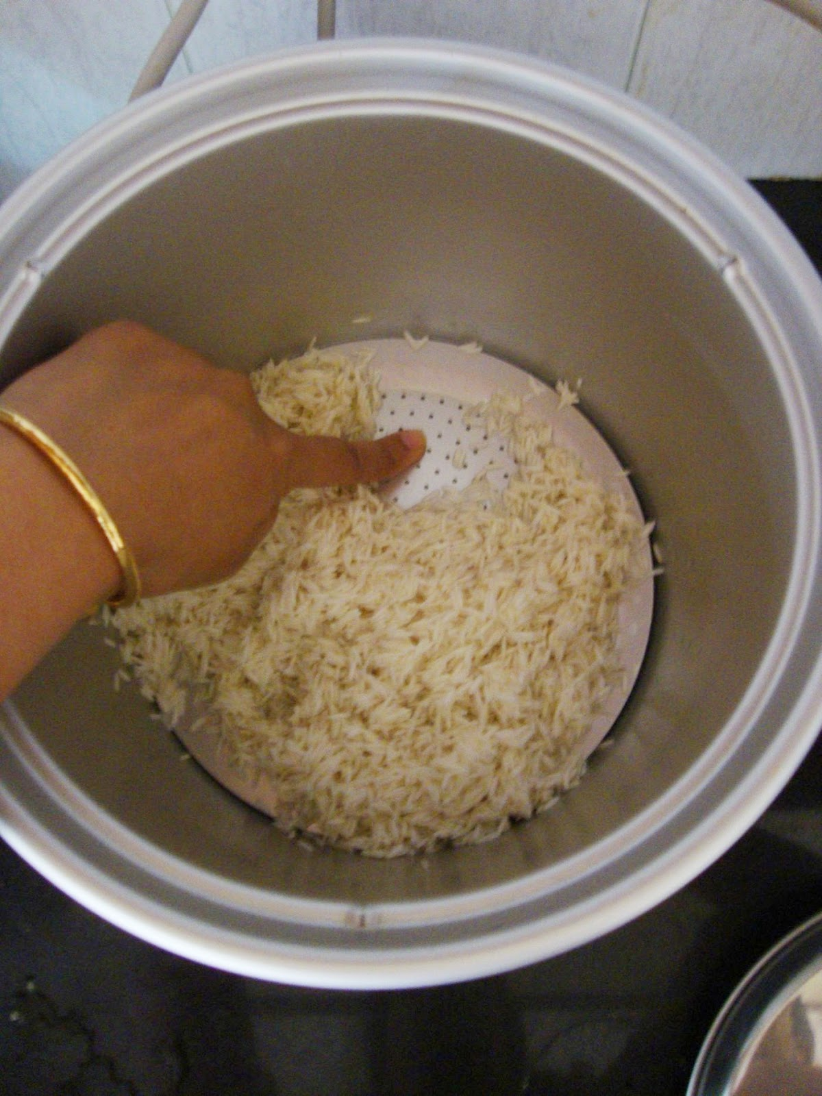 Keep Ready Your Rice Cooker By Placing The Separator Plate At The  Bottom(see Above Pic Where I Am Showing) Add Rice (except Water), All The  Vegetables,