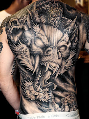 Japanese people use dragon tattoos to show their power and position. they also use to rank up their people with numbers of dragon on their body.