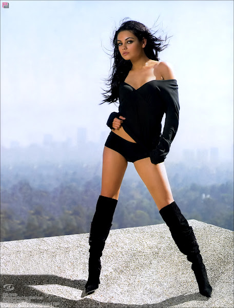 mila kunis hot sexy pose on rock