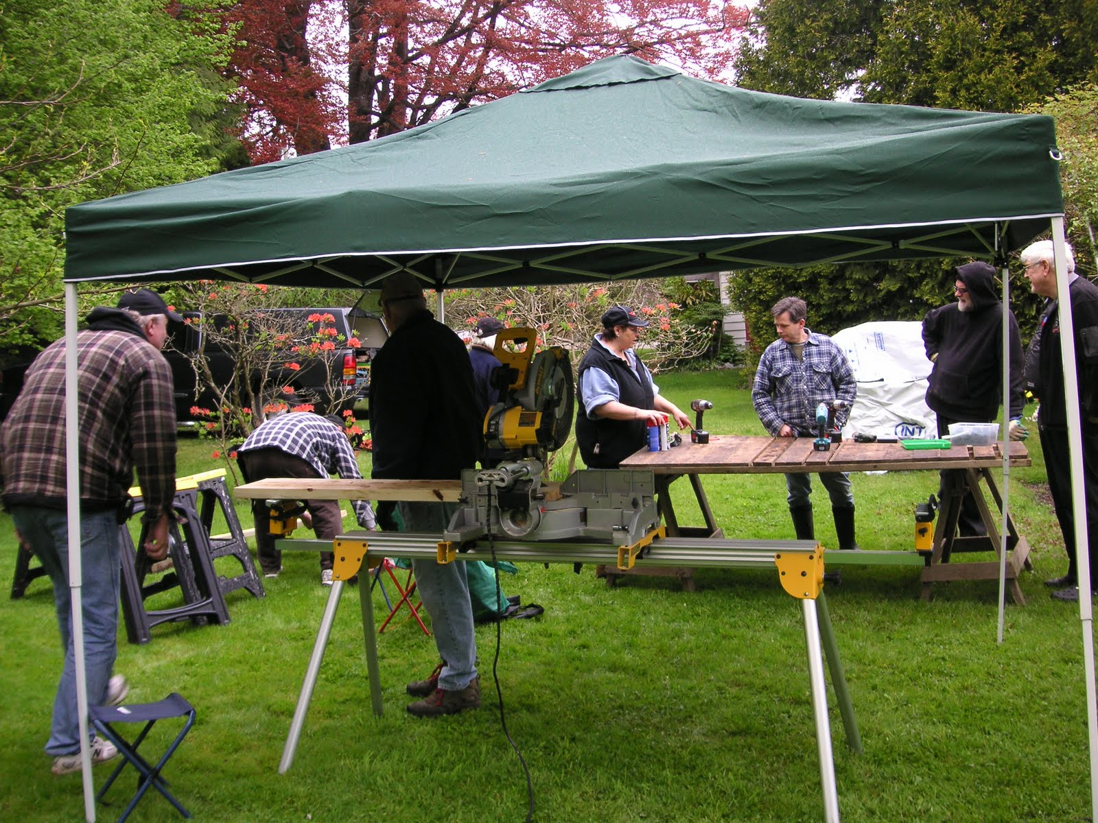It rained lightly at first but the tent kept the power tools dry. We gardeners werenu0027t put off by a bit of ... & Ladner Community Garden: Build a Bed day for the Community Garden