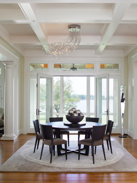 Contemporary Lamp above the Small Dining Space with Dark Round Dining Tables and Wooden Chairs on Grey Carpet