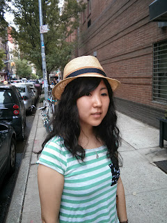 Straw Hat on young lady at The Hat House NYC