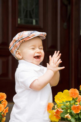 Little baby boy kid laughing Photos