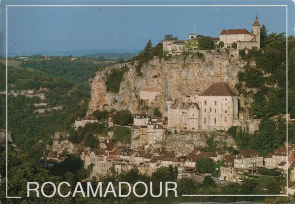 view of Rocamadour with buildings arranged up the cliff face