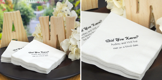 White napkins printed with facts about the bride and groom.