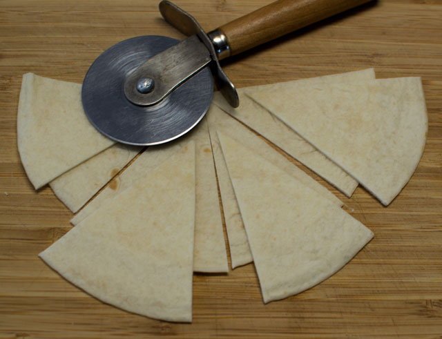 slicing flour tortillas for chips