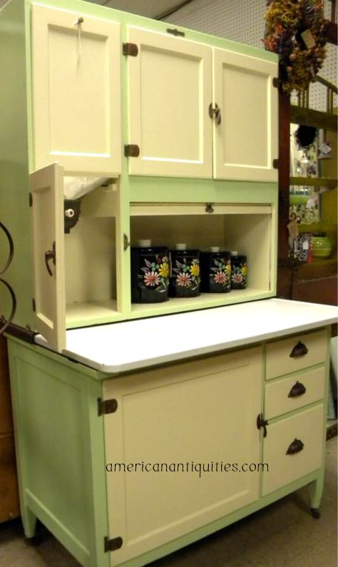 As the Baker's Cabinet evolved into the Hoosier style, the lower sections  were replaced with a base that had a door on one side. - The Country Farm Home: I'll Take A Hoosier Cabinet, Please