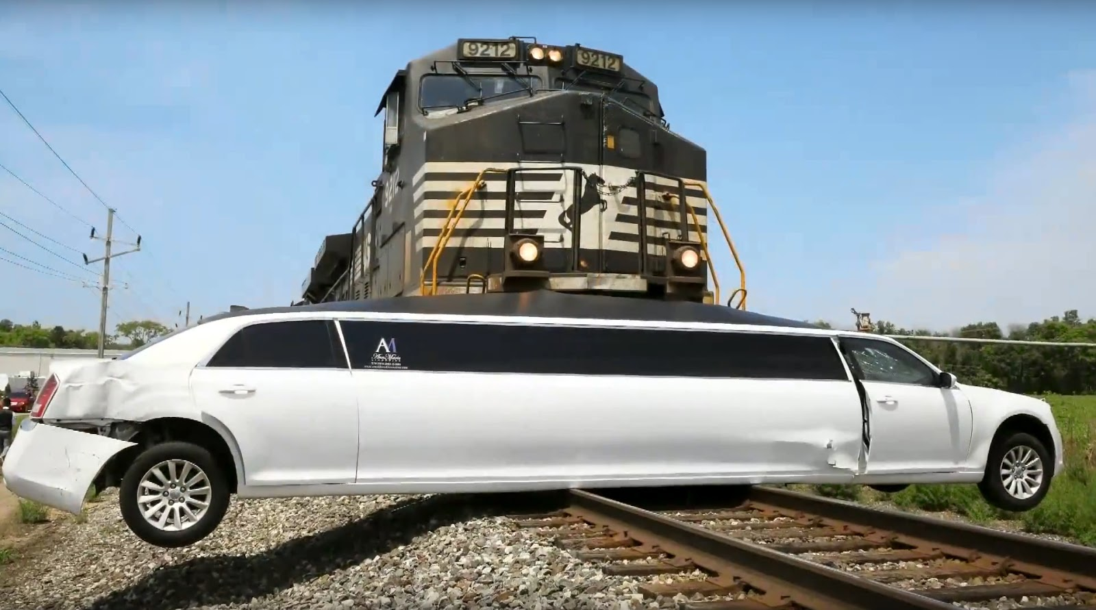 Yikes Watch Train Crash Into Stuck Chrysler Limo In