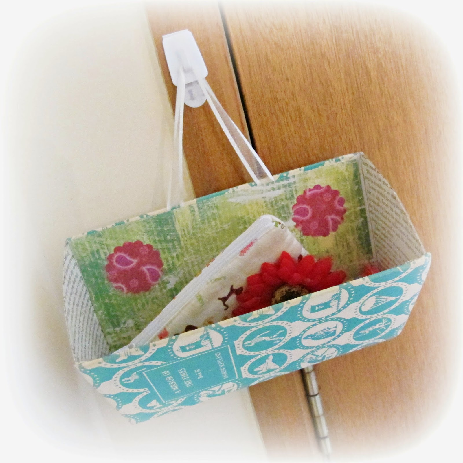 image green and pink upcycled book caddy storage solution wall pocket
