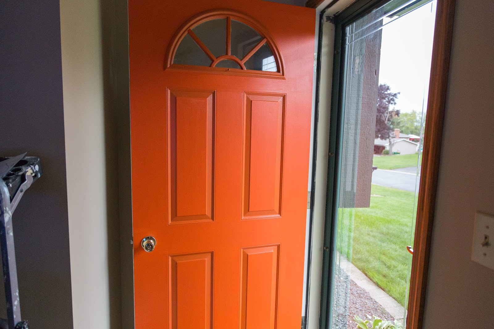 I even started just putting coats of orange on the insets where the tan paint was...it helped a little but the whole door still needs another coat. & Russet Street Reno: Orange is the new red