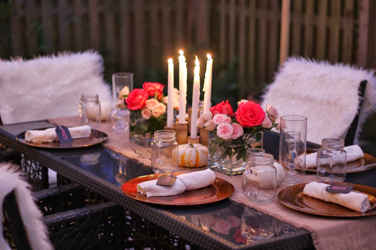 fall table setting pumpkins flowers roses fire pit cafe lights