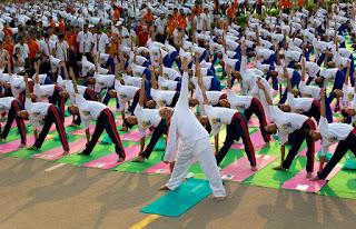 Narendra Modi leading the Yoga demonstration at Rajpath, Delhi
