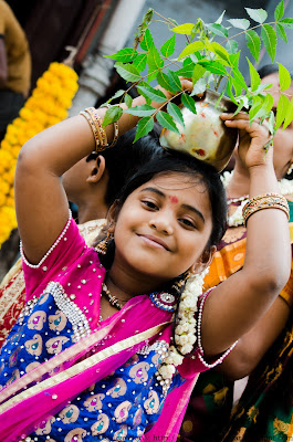 girl with bonalu with neem leaves on her head