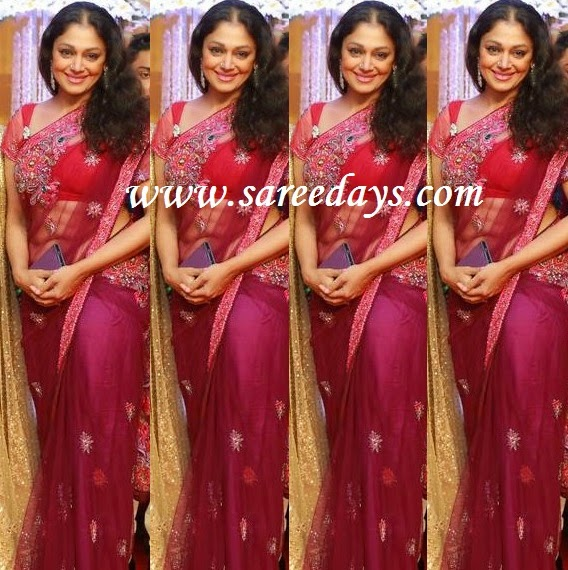 Latest saree designs shobana in magenta pink net saree checkout shobana in magenta pink net saree with embroidery motifs and paired with matching short sleeves blouse altavistaventures Image collections