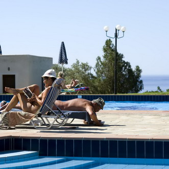 Relaxing at the pool at Vitromartis Naturist Resort (Crete, Greece)