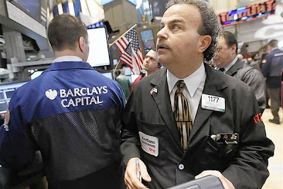 Stocks gain on Greece, Dow briefly hits 13,000