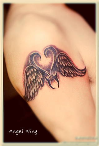 Angel wing tattoo designs on the arm with totem between two wing