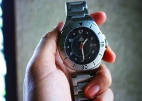Hand held watch.