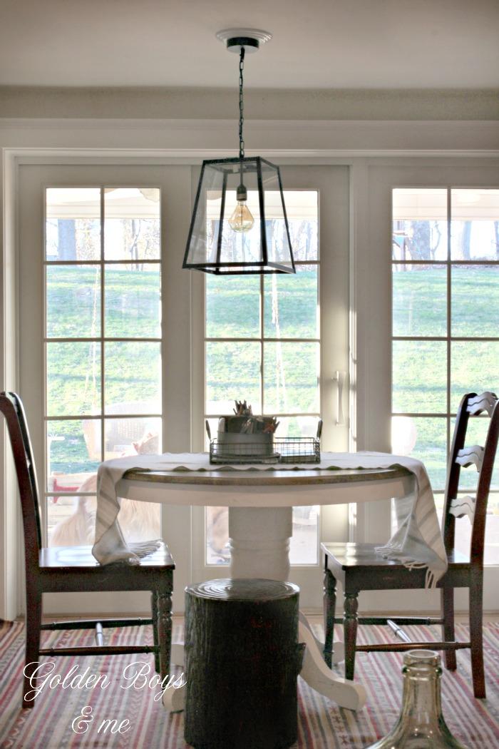 orld Market 4 sided glass pendant lantern in family room - www.goldenboysandme.com