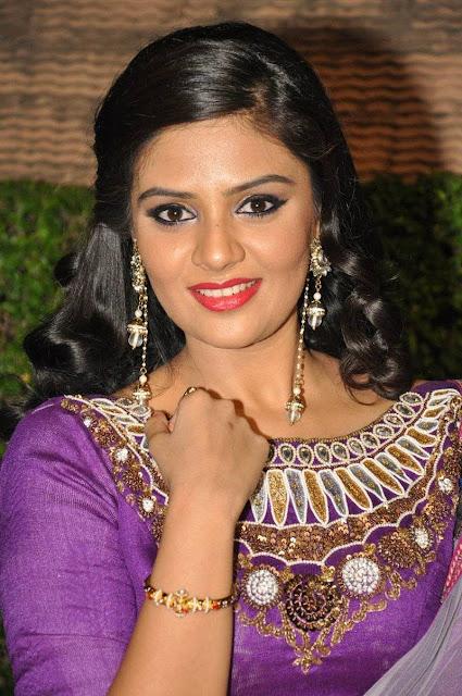 Srimukhi in a Purple Ghgra Choli and Transparent Shaded Dupatta at Dhakshmi Talupu Tadithey Audio Launch