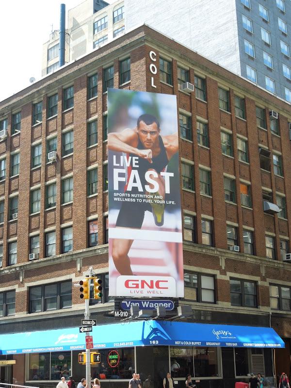 GNC Live Fast hurdler billboard NYC