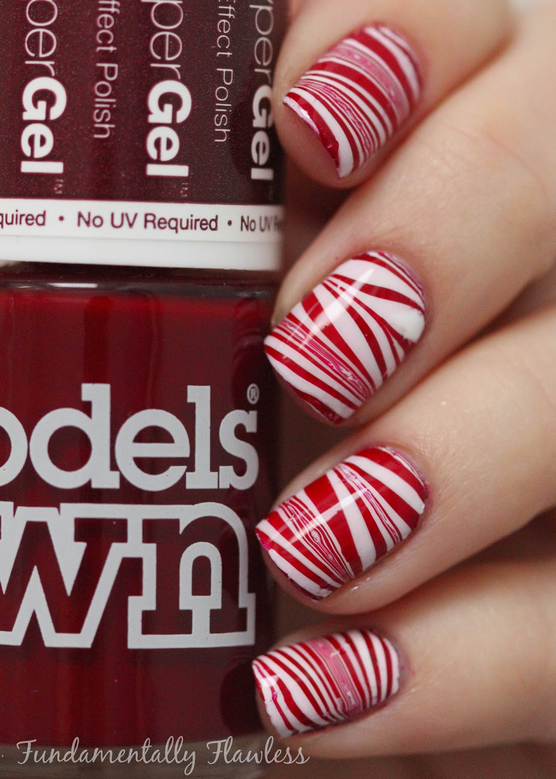 Candy cane watermarble nail art with Models Own Brunette Red