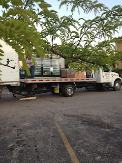 Load-transfer-unload-semi-truck-flatbed-tractor-skid