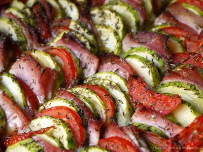 Tian de courgettes au jambon, comté et tomates (voir la recette)