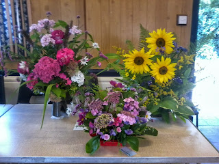 A lovely assortment of flower arrangements were entered.