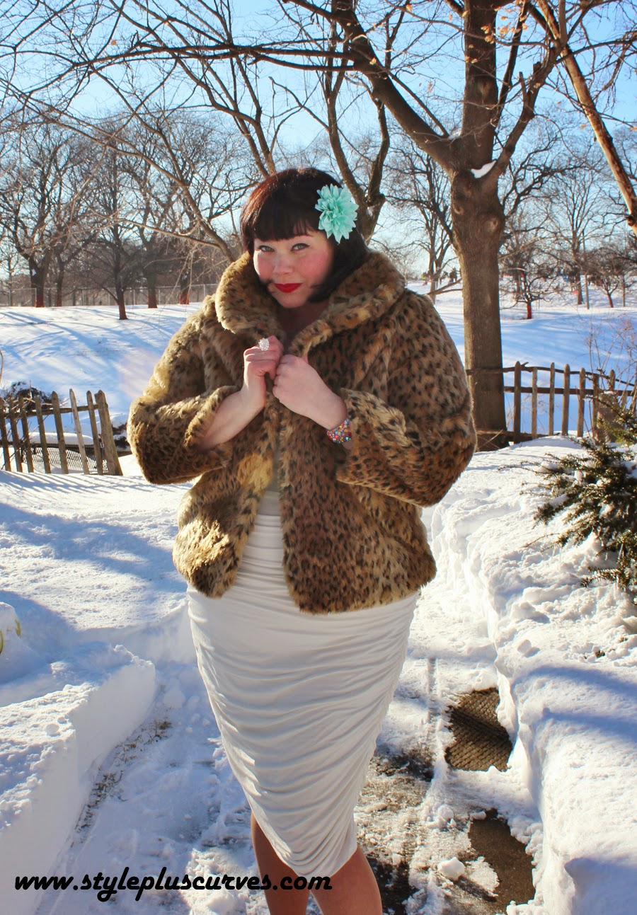 Amber from Style Plus Curves Models a plus size Leopard Print Jacket over a white dress