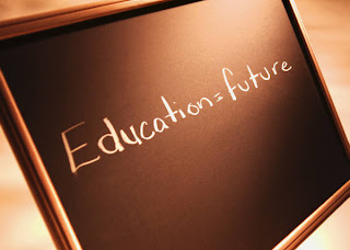 Educator=future written on a chalkboard.