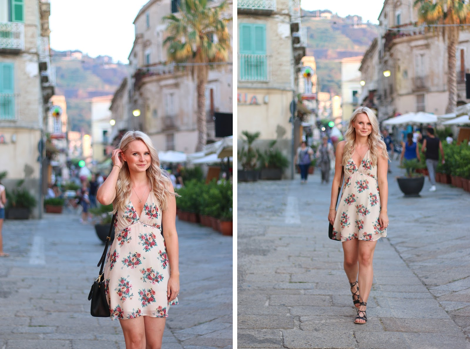 a blonde girl stands in the streets on italy, wearing a floral dress, happy and joyful on holiday
