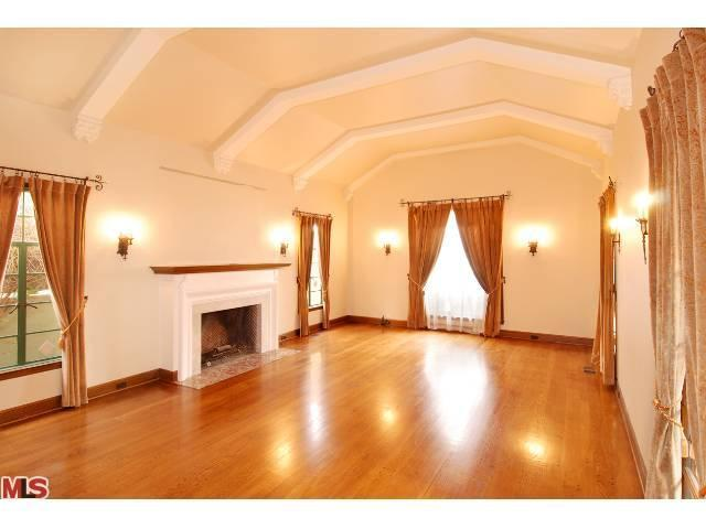 massive living room is full of character beamed ceiling wall sconces