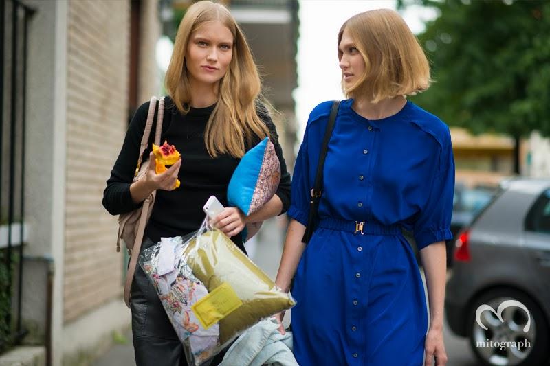 Model Katya Riabinkina and Irina Nikolaeva are leaving Etro 2014 Spring Summer Milan Fashion Show.