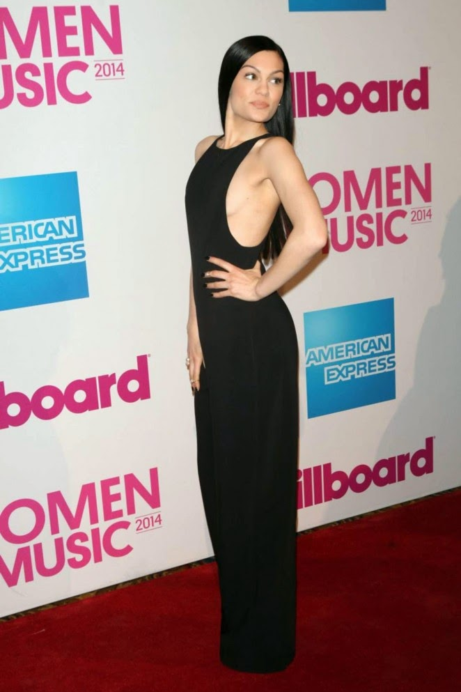 Jessie J reveals side-boob in a halter jumpsuit at the 2014 Billboard Women in Music Luncheon in NYC