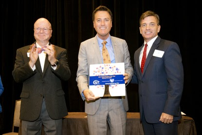 Michael W. Smith is presented with the  Philanthropist of the Year Award by the AFP