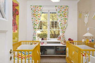 dormitorio para dos bebés