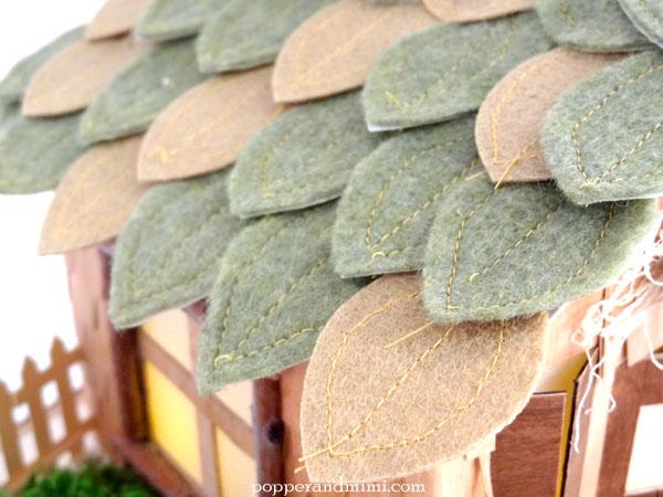 Die cut, stitched felt leaf roof on rustic woodland house decor | popperandmimi.com