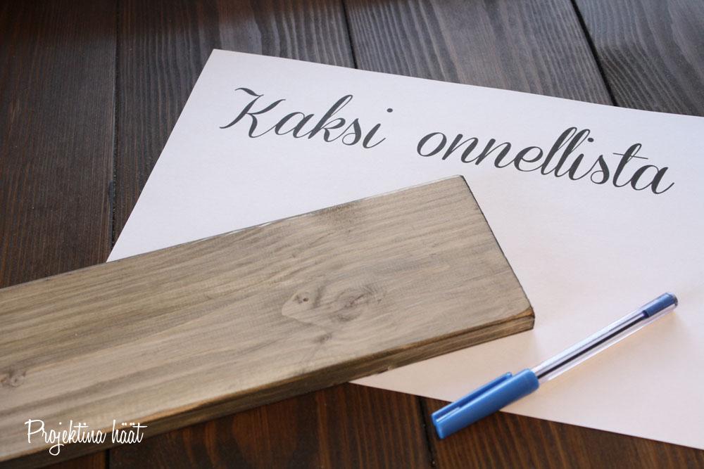 Tekstitaulu suomeksi