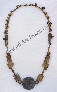 The Baoule of the Ivory Coast shares a common history and culture with the Asante. In both cultures, gold was generally available only to royal household members. Thus, goldsmiths created beads for most people in bronze, shown here, matching the styles of gold beads.