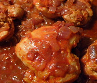 Chicken Cooking in Paprika-Onion Sauce