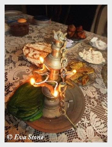 Eva Stone photo, oil lamp, ceremony, avurudu, sweets, new year Sri lanka