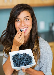 Smiling Brunette with Bowl of Blueberries
