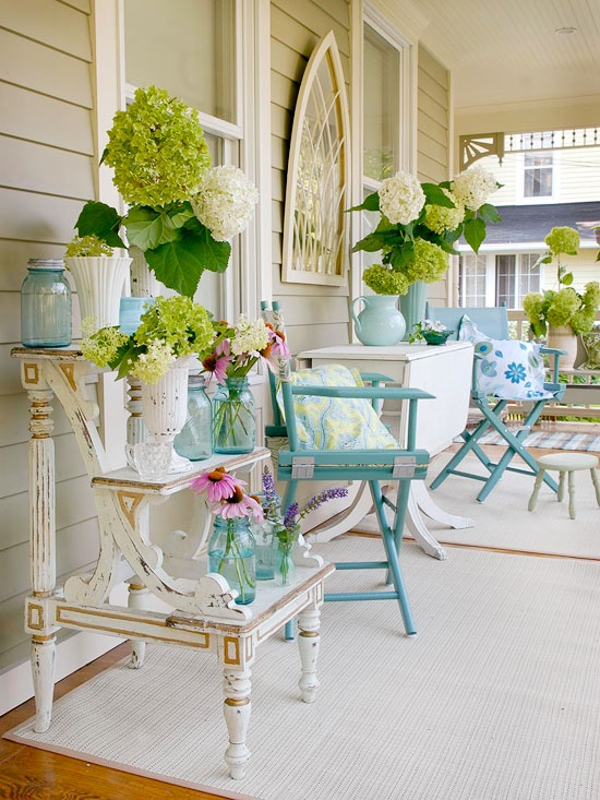 This front porch decor is bright and ready for spring with a green, turquoise and white color scheme