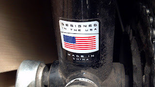 bicycle sticker that says designed in the usa made in china