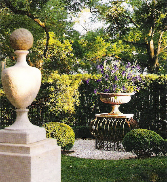 Veranda Magazine, garden element: stone finial, flower-filled urn, fencing, edited by lb for linenandlavender.net, http://www.linenandlavender.net/2011/07/patience-my-dear.html